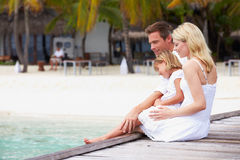 Family Sitting On Wooden Jetty Royalty Free Stock Image