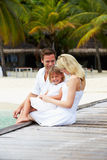 Family Sitting On Wooden Jetty Royalty Free Stock Photos