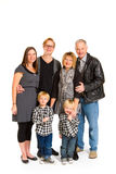 Family of Six Isolated. This group of six people includes three generations on an isolated white background in the studio Royalty Free Stock Photo