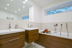Family size bathroom. With two hand wash basins and a bath tub Royalty Free Stock Photo