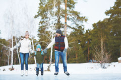 Family on skating-rink Royalty Free Stock Images