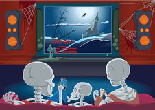 Family of skeletons are watching TV Stock Photography