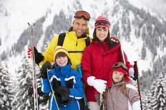 Family On Ski Holiday In Mountains Royalty Free Stock Photos