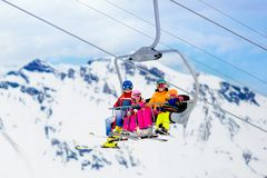 Family in ski lift in mountains. Skiing with kids stock photos