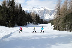 Family on a ski-run Royalty Free Stock Photo