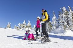 Family on the ski slope Royalty Free Stock Photos