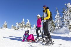 Family on the ski slope Royalty Free Stock Photo
