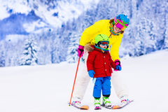 Family ski and snow fun in winter mountains Royalty Free Stock Images