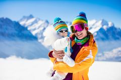 Family ski and snow fun in winter mountains Royalty Free Stock Photography