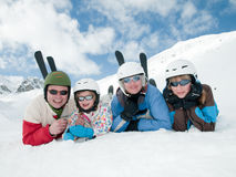 Family, ski, sun and fun. Parents with daughters in ski resort Royalty Free Stock Image