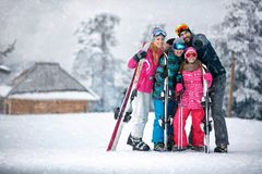 Family, ski, sun and fun on vacation in mountains Stock Images