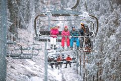 Free Family Skier And Snowboarder Lifting On The Chairlift At Ski Res Royalty Free Stock Photos - 129964778