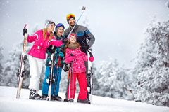 Family making selfie together at snowy mountain Royalty Free Stock Photography