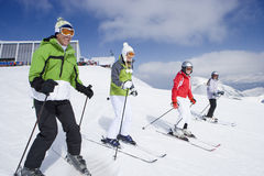 Family of skiers skiing downhill on ski slope Stock Photography