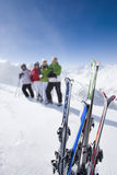 Family of skiers smiling together on mountain top Royalty Free Stock Photo