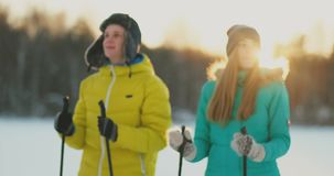 Family skiers spend the weekend together doing skiing in the woods. Healthy lifestyle. Slow motion. Loving couple stock video
