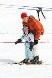 Family skiing Stock Images