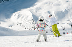 Family skiing. Mother with daughter skiing downhill Stock Photography