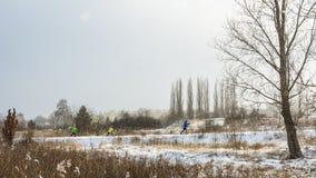 Family skiing in city park. stock photos