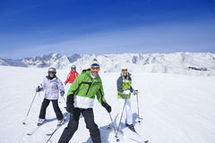 Family skiing on mountain top Stock Image