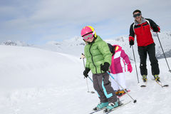 Family skiing on the slopes Royalty Free Stock Photography