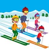 Family Skiing Snow. Happy family of four members skiing on snow mountain Stock Photo