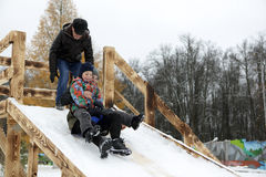 Family skiing on snow saucer Royalty Free Stock Photography