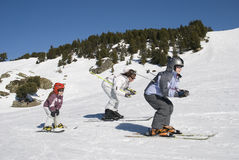 Family is skiing during winter sport Stock Photos