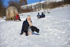Family sledding in winter on the snow Royalty Free Stock Photos