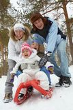 Family on sledge Stock Photography