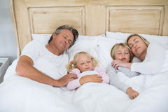 Family sleeping on bed in the bed room Royalty Free Stock Photography