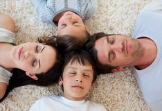 Family sleeping on the floor Royalty Free Stock Photos