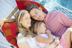 Family Sleeping In Garden Hammock Together Stock Image