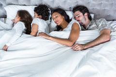 Family sleeping together Stock Images