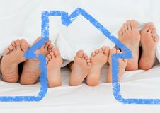 Family sleeping together with house outline Royalty Free Stock Images