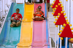 Family Slides Down Fun Slide At Atlanta Fair Royalty Free Stock Images