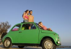 Family with small car on vacation Stock Photography