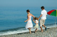 Family with small girl. Go on seaside Stock Image