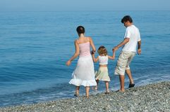 Family with small girl. Go on seaside Stock Images
