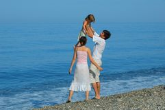 Family with small girl. On a beach Royalty Free Stock Images