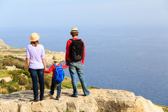 Family with small kid travel hiking in mountains Royalty Free Stock Photo
