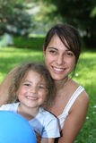 Family smile. Woman and child in the garden Stock Photography