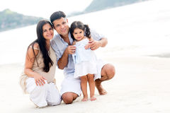 Family smiling at the beach Stock Image