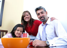 Family smiling and dining Stock Images