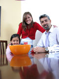 Family smiling and dining Royalty Free Stock Image