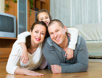 Family smiling at the floor Stock Image