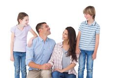 Family smiling while looking at each other Royalty Free Stock Photos