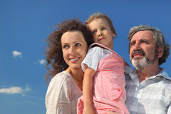 Family smiling and looking at side Stock Photos