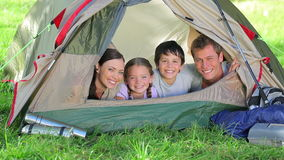 Family smiling while lying in a tent stock video