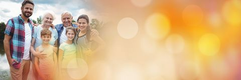Family smiling outside with orange bokeh transition Stock Image